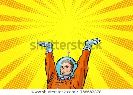 template astronaut holding something on his hands Stock photo © studiostoks