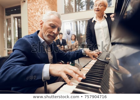 old man sitting at piano Stock photo © IS2