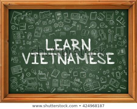 learn vietnamese   hand drawn on green chalkboard stock photo © tashatuvango