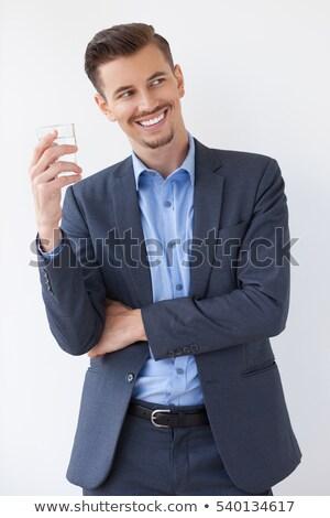 Férfi üveg víz mosolyog törik üzletember Stock fotó © IS2