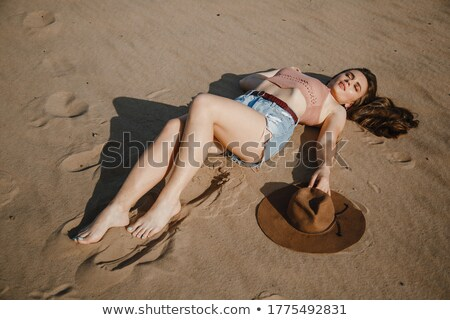 Woman with cowboy hat lying in meadow Stock photo © IS2