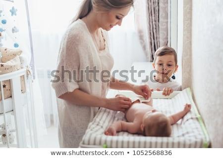 Stock fotó: Mum Changing Nappy To Her Newborn
