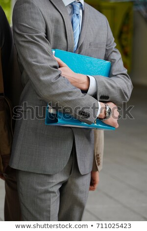 Businessman carrying folder in courtyard Stock photo © IS2