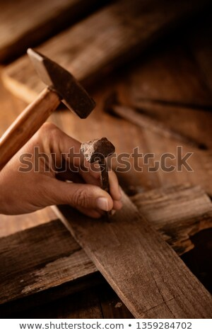 man driving a nail on a wooden cross Stock photo © nito