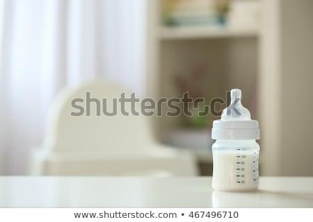 infant milk formula in baby bottle on table Stock photo © dolgachov