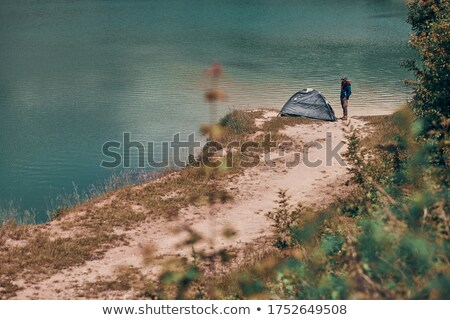 Woman looking into tent Stock photo © IS2
