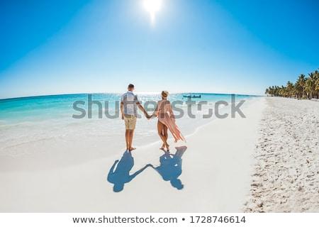 カップル 熱帯ビーチ 徒歩 日没 バリ 島 ストックフォト © joyr