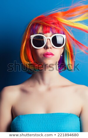 happy woman wearing colorful dress and blue wig stock photo © acidgrey