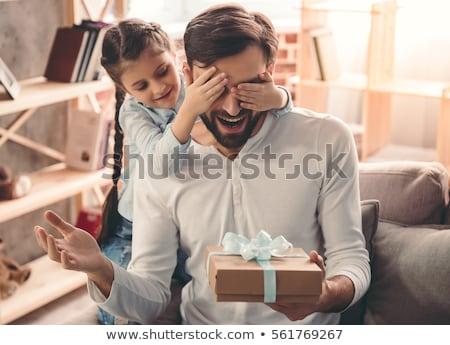 Feliz pai pequeno filha festa de aniversário família Foto stock © dolgachov