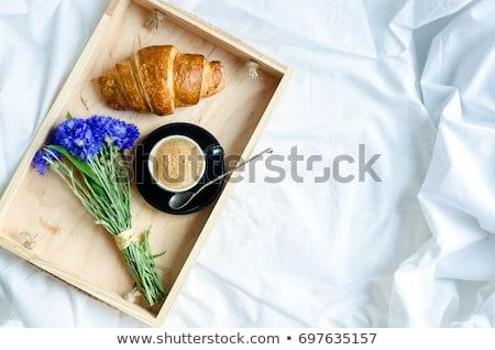 Jóreggelt kontinentális reggeli fehér ágy csésze kávé Stock fotó © Illia