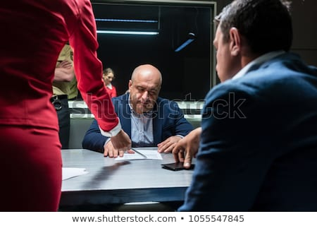 Suspect or witness during police interrogation Stock photo © Kzenon