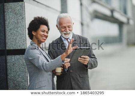 senior · zakenvrouw · computer · werken · kantoor · met · behulp · van · laptop - stockfoto © minervastock