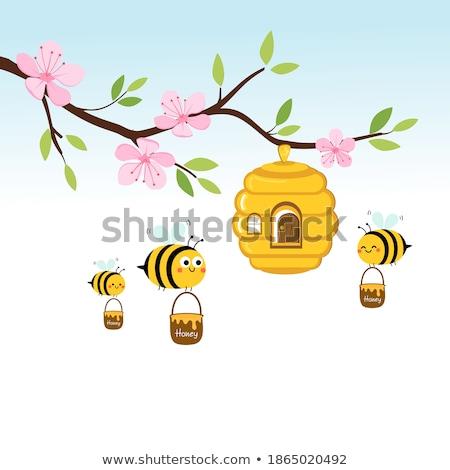 wooden sign with bee flying in garden stock photo © colematt