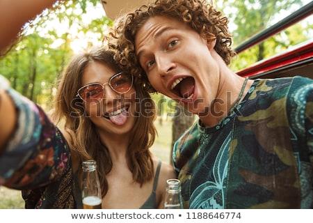 Fotó hippi pár férfi nő mosolyog elvesz Stock fotó © deandrobot