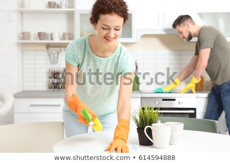 Boldog férfi takarítás bútor szalvéta mosolyog Stock fotó © AndreyPopov