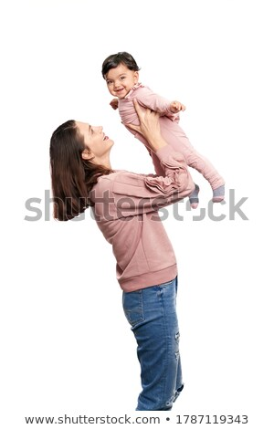 woman holding cute daughter posing in studio stock photo © studiolucky