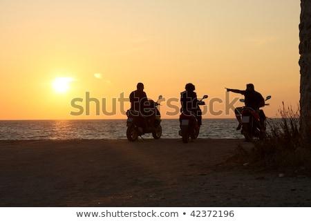Homem motocicleta mar nuvens estrada verão Foto stock © galitskaya