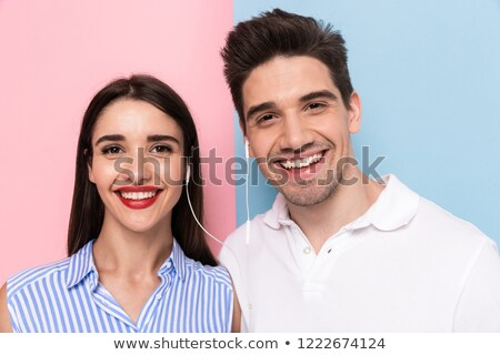 image closeup of cheerful couple wearing earphones together and stock photo © deandrobot