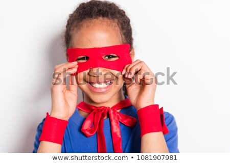 Portrait of girl in superhero costume against grey background Stock photo © Lopolo