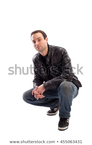 Young Man Crouching In Studio Stock photo © monkey_business