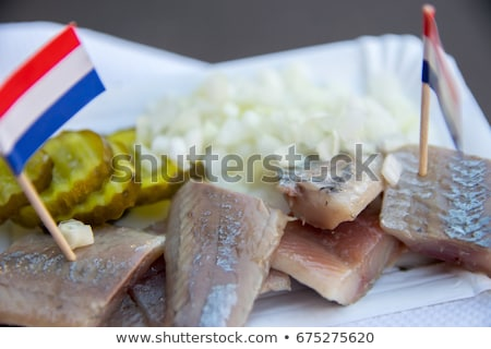 Traditional dutch snack, seafood sandwich with herring Stock photo © Melnyk