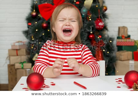 Cute kid grimacing in santa costume Stock photo © nyul