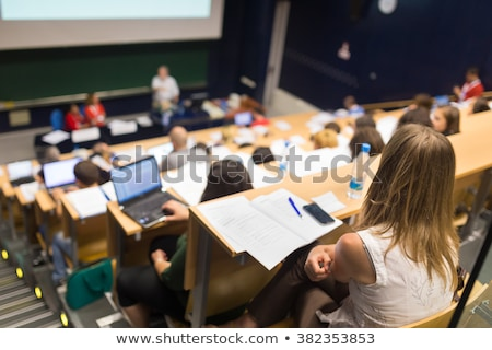 group of students and teacher at lecture hall Stock photo © dolgachov