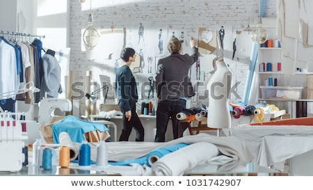 Young man and woman choosing textile for new fashion collection in studio Stock photo © pressmaster