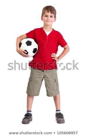Aranyos fiú tart futball labda izolált Stock fotó © Lopolo