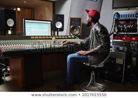 Fiatal zenész afrikai nemzetiség ül munkahely Stock fotó © pressmaster