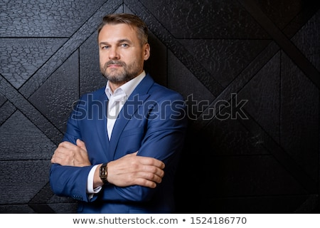 Successful serious businessman in formalwear crossing his arms on chest Stock photo © pressmaster