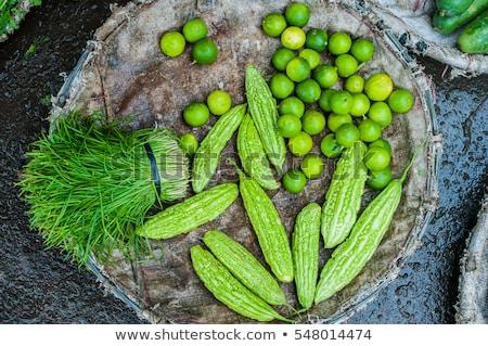 Limes in the wicker basket on the Vietnamese market. Asian food concept Stock photo © galitskaya