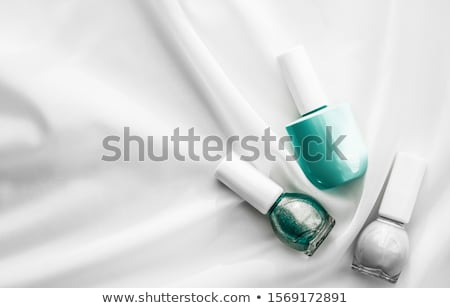 Stock photo: Nail polish bottles on silk background, french manicure products