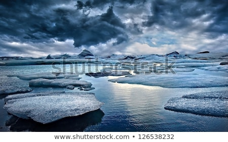 Iceberg and ice from glacier in dramatic arctic nature landscape on Greenland Stock photo © Maridav