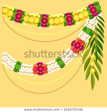 Flower garland and palm leaf. Indian mala traditional ornate decoration Stock photo © orensila