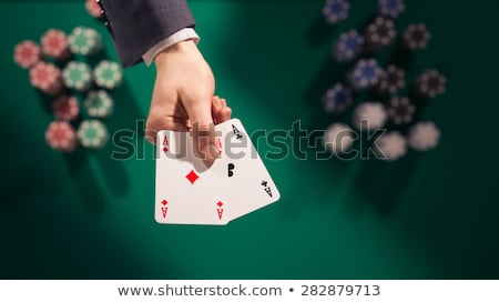 Two cards in hand on a Casino table Stock photo © cienpies