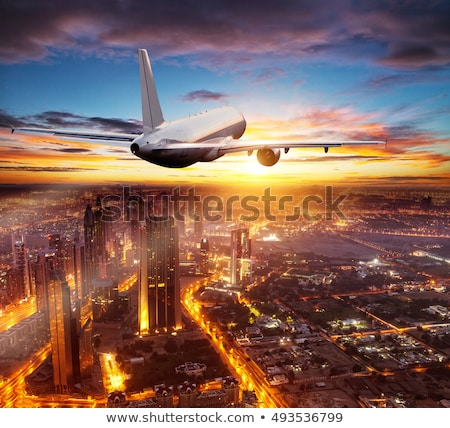 Commercial Airplane Flying Over Dubai City Stock photo © AndreyPopov