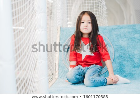 Pretty little Asian girl with long hair wearing costume of super girl Stock photo © pressmaster
