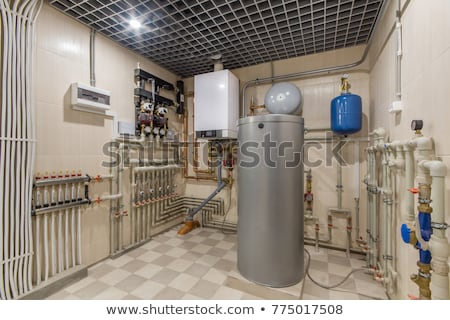 heating system and valve equipment in a boiler room Stock photo © Lopolo