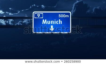 Мюнхен дорожный знак зеленый шоссе знак облаке дороги Сток-фото © kbuntu