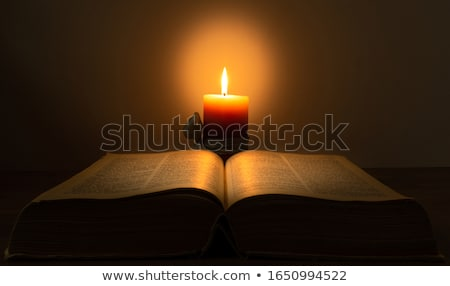 open book with burning candle stock photo © andreykr