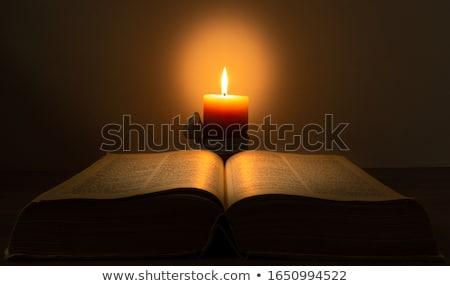 Open boek brandend kaars leggen tabel boek Stockfoto © AndreyKr