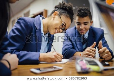 öğrenci ayakta üniforma beyaz gölge Stok fotoğraf © lovleah