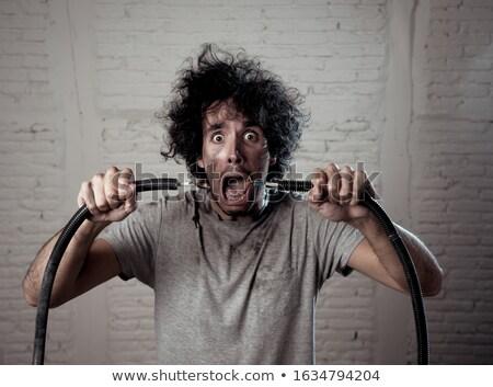 Man elektrische schok gezicht achtergrond zwarte Stockfoto © photography33