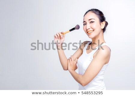 Portrait of a woman holding brushes Stock photo © konradbak