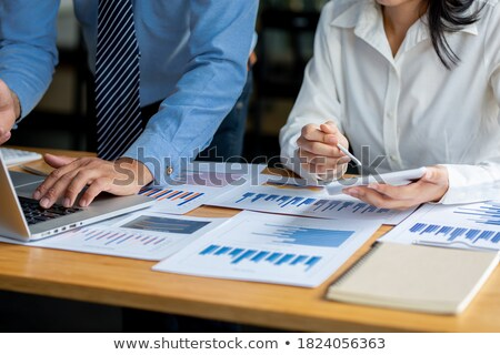 A team of business professionals calculating their budget Stock photo © photography33