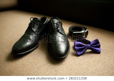 Stock photo: white shoes and a garter