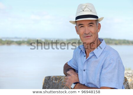 Senior sightseer looking over an estuary from an elevated position Stock photo © photography33