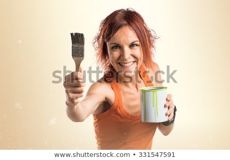 Portrait of a pretty girl holding paint can Stock photo © photography33