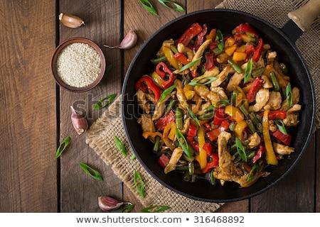 Rood wok schaal lege koekenpan geïsoleerd Stockfoto © ivonnewierink